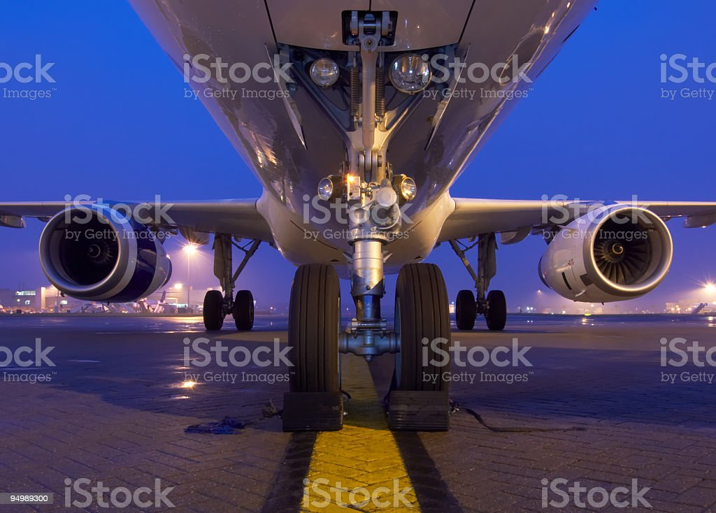 A commercial airliner preps for takeoff on the Tarmac stock photo