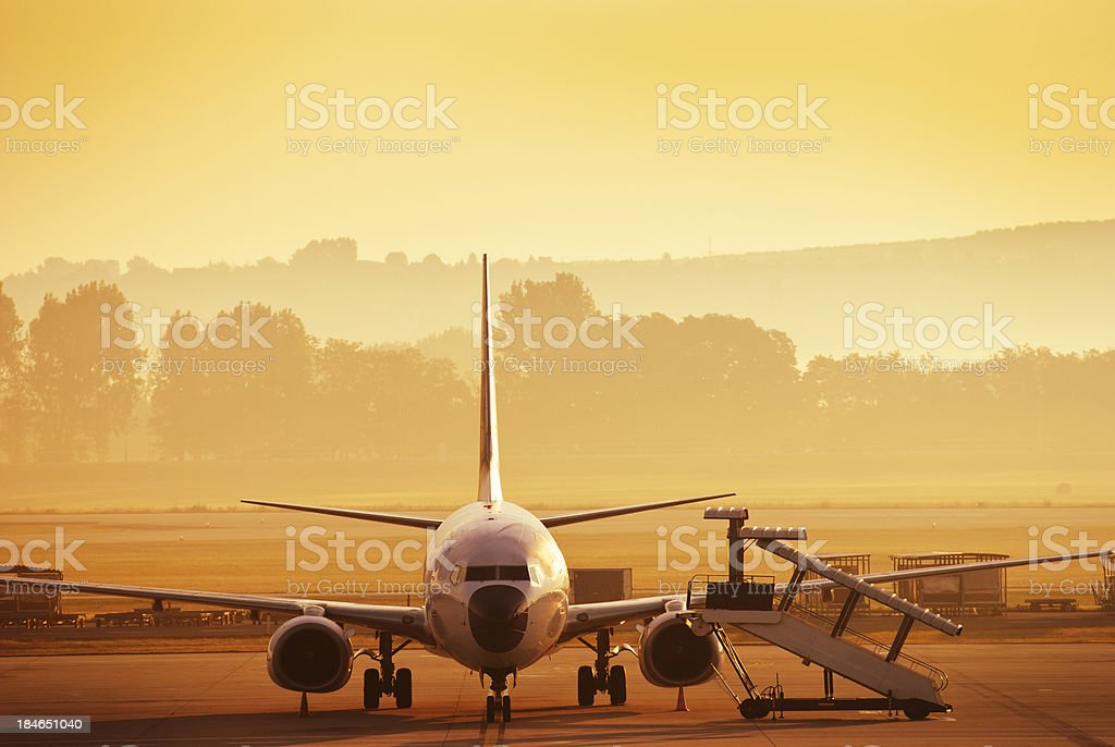 commercial airplane at sunset royalty-free stock photo