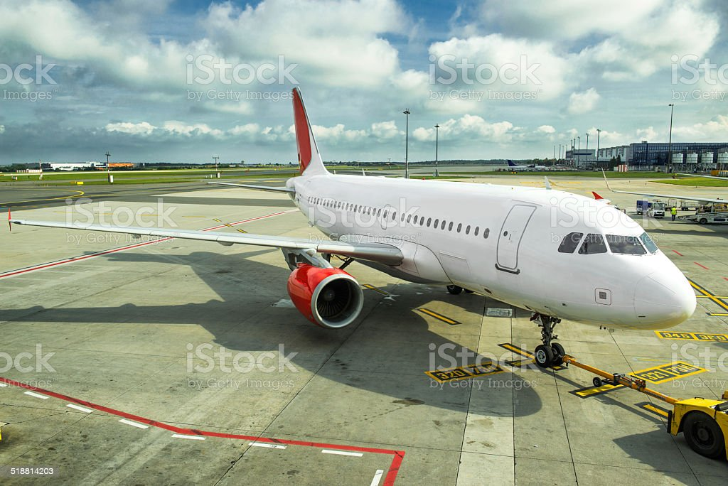 Commercial airplane at the airport stock photo