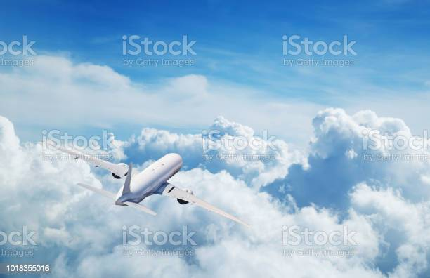 Photo of Commercial airplane flying above clouds