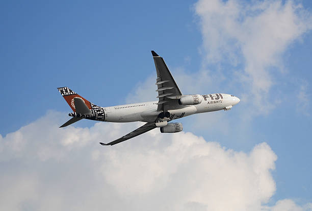 commercial airplane flying in the sky - respiratory tract stock photos and pictures