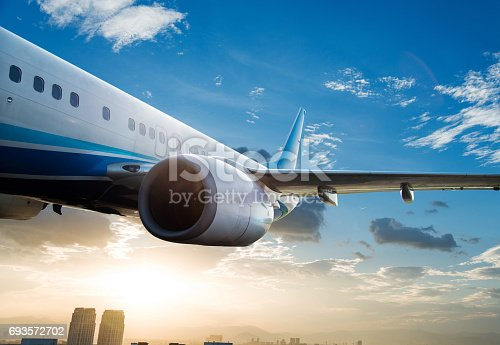 155439315istockphoto Commercial airplane flying over clouds 693572702