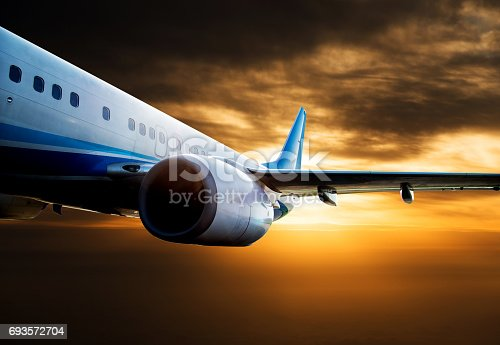 155439315istockphoto Commercial airplane flying over clouds 693572704