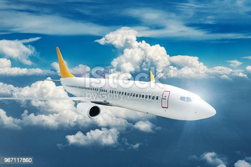 155380716 istock photo Commercial airplane flying over clouds 967117860