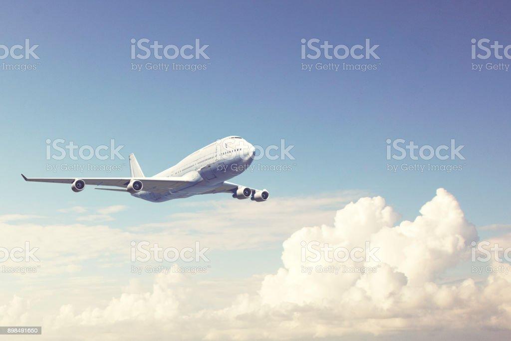 avião comercial a voar sobre as nuvens - foto de acervo
