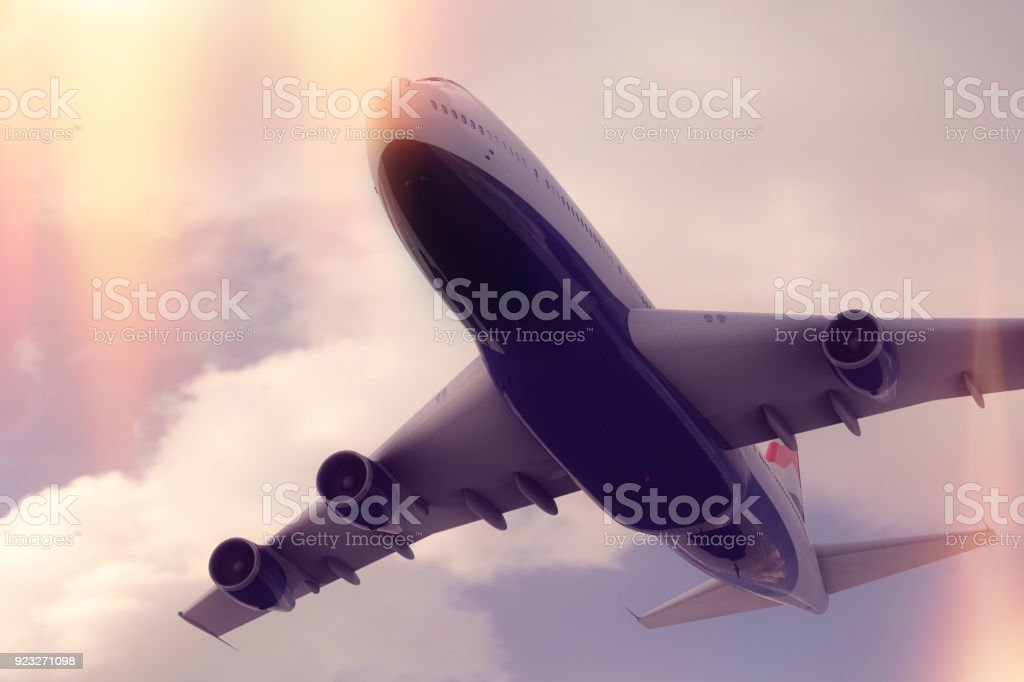 Commercial Airplane in the sky stock photo