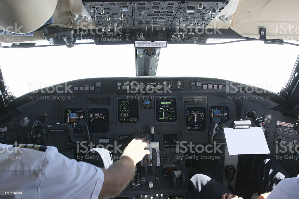 Commercial airplane landing on airport...pilot checking data royalty-free stock photo