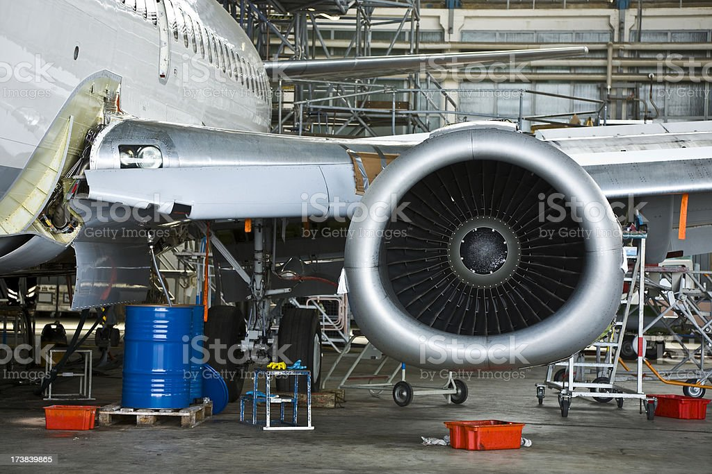 Commercial Airplane Maintenance Check in Hangar stock photo