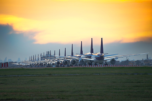 Commercial airplane parking at the airport are stopped effect by covid-19