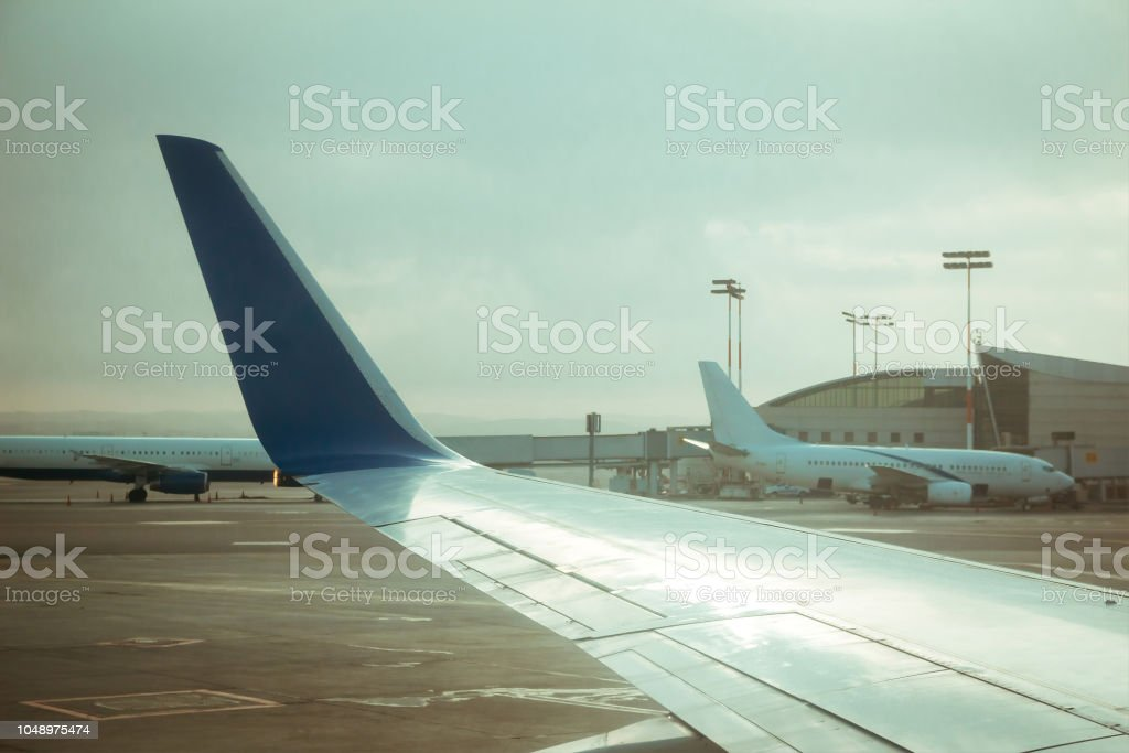 Commercial airplane wing and other commercial airplanes near terminal 3 at Ben Gurion international airport stock photo