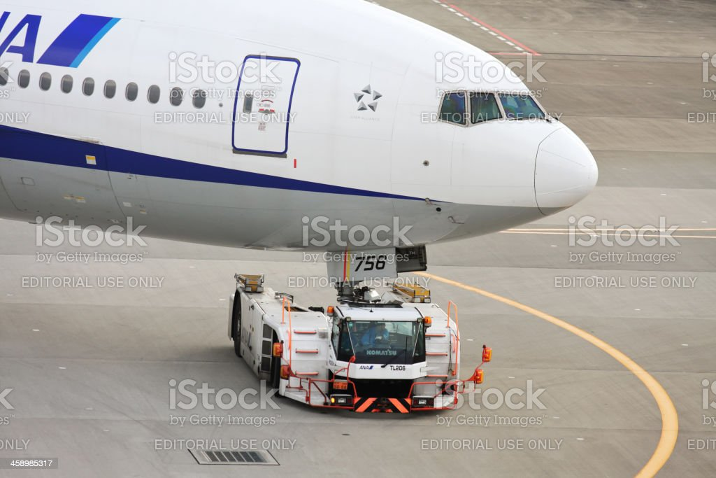 Commercial ANA airplane being towed to a gate royalty-free stock photo
