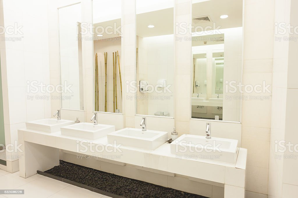 ... Commercial Bathroom. Stock Photo Drain Sink ...