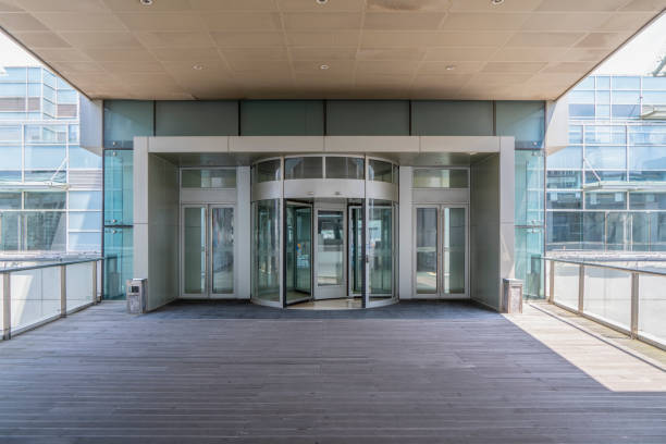 commercial building entrance - entrance stock photos and pictures