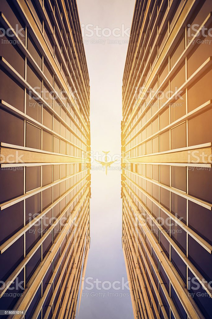 Commercial buildings with an airplane stock photo