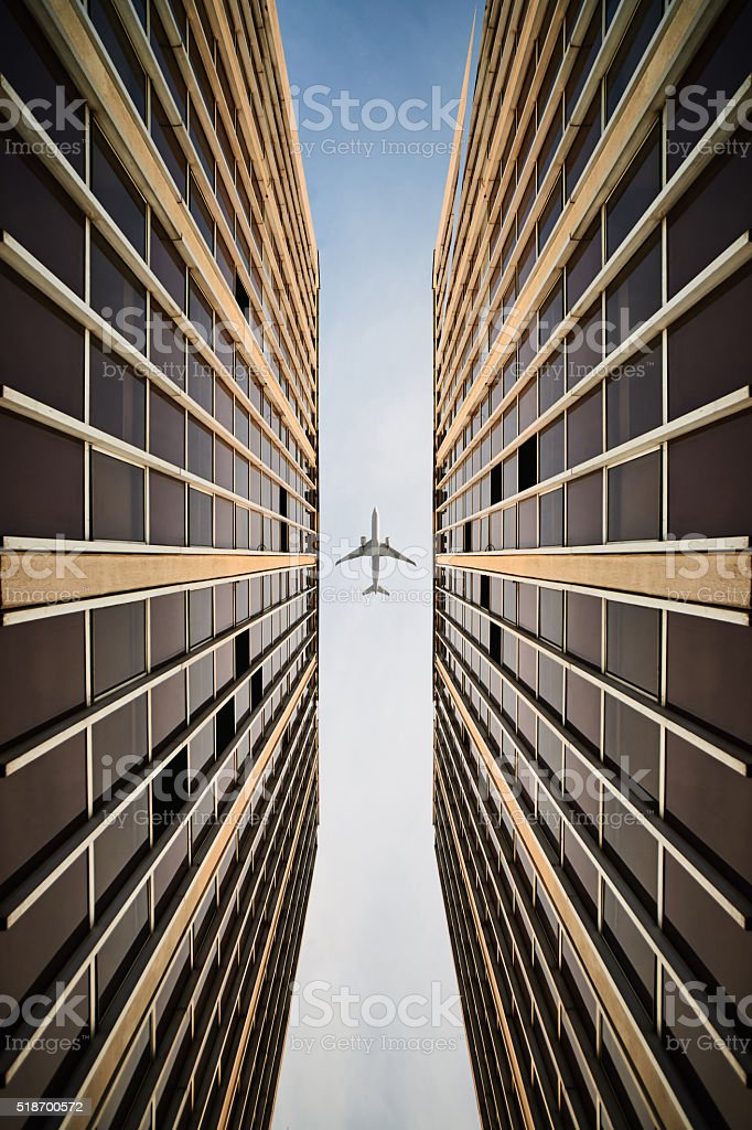 Commercial buildings with an airplane. stock photo