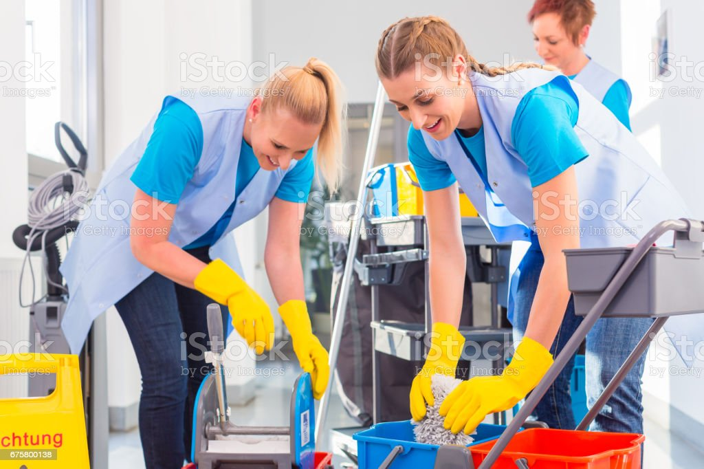 Commercial cleaners doing the job together stock photo