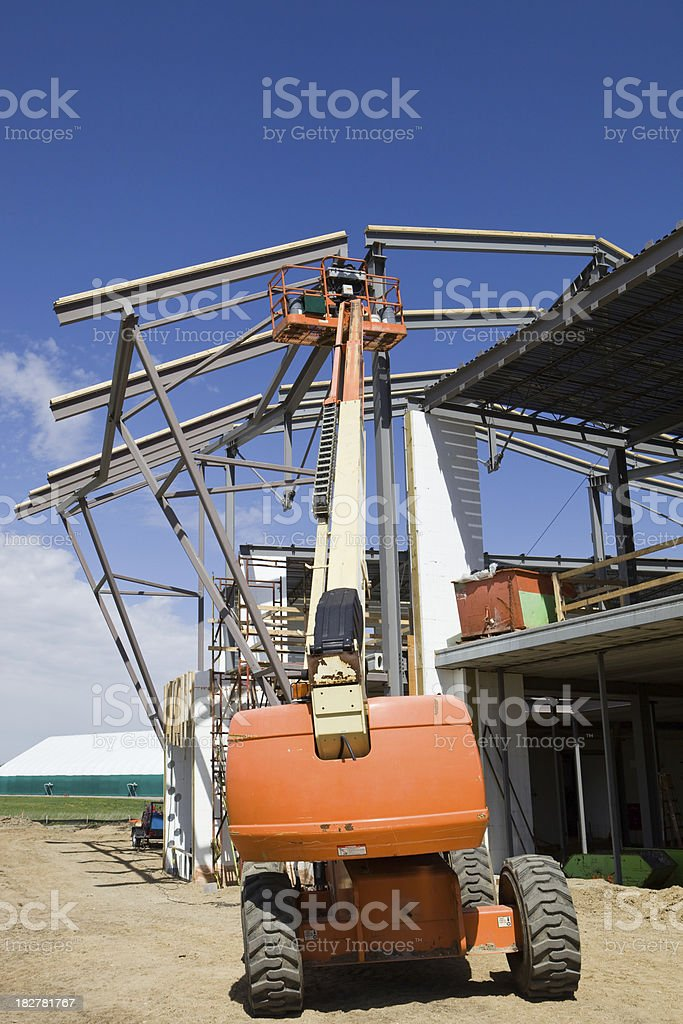 Commercial Construction Site with Aerial Work Platform royalty-free stock photo