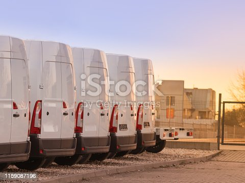 1140988145 istock photo commercial delivery vans in row 3 1159087196