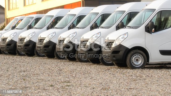 1140988145 istock photo commercial delivery vans in row 1146970516