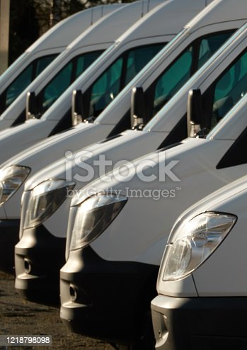 1140988145 istock photo Commercial delivery vans, parked in a row. 1218798098