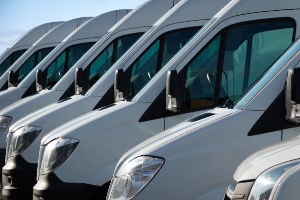 Commercial delivery vans, parked in a row. stock photo