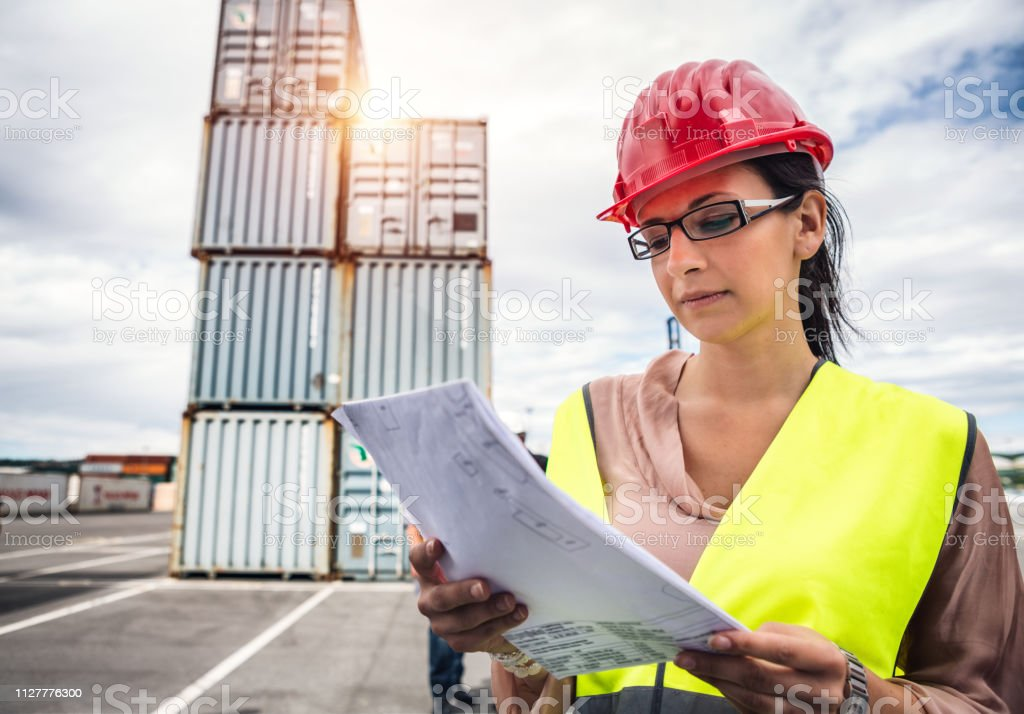 Commercial Dock Employee At Work stock photo