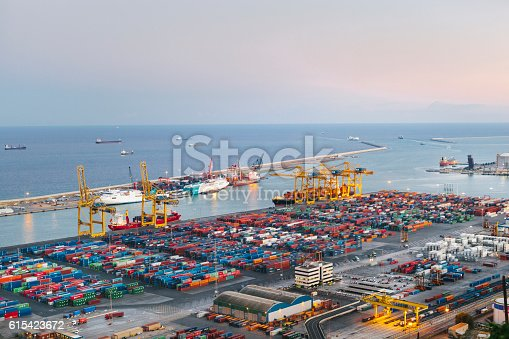 istock Commercial Dock With Containers And Cranes 615423672