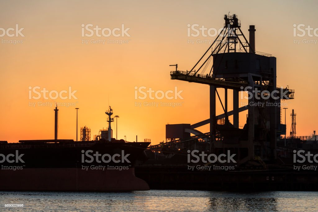 Commercial dock with ship and crane conveyor belt stock photo