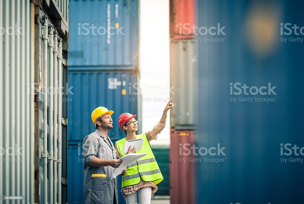 Commercial docks worker and inspector at work stock photo