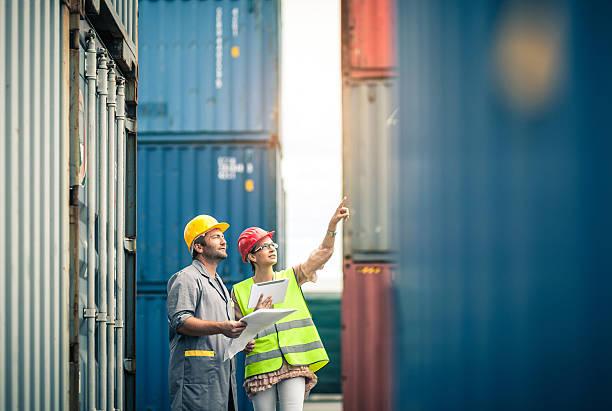 commercial docks worker and inspector at work - haven stockfoto's en -beelden