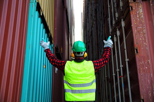 Commercial docks worker Commercial docks worker. customs official stock pictures, royalty-free photos & images