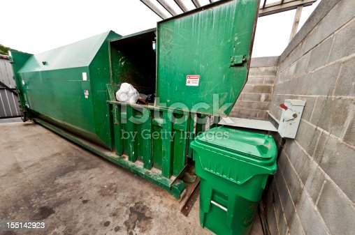 A large combination compactor/dumpster that serves a large apartment community.