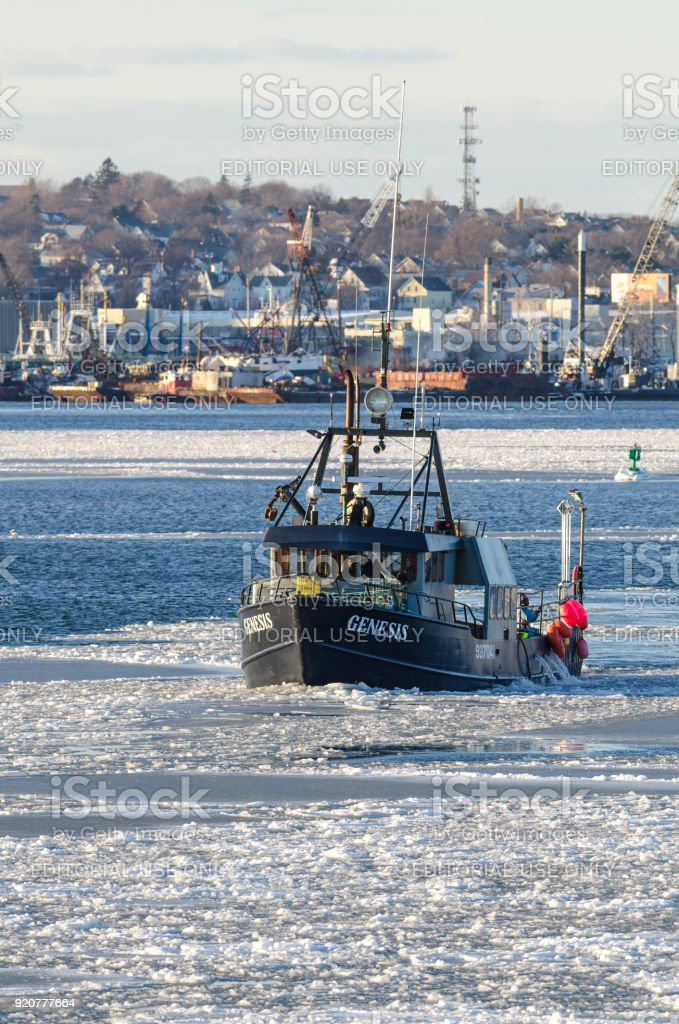 Commercial fishing boat Genesis in icy New Bedford harbor stock photo