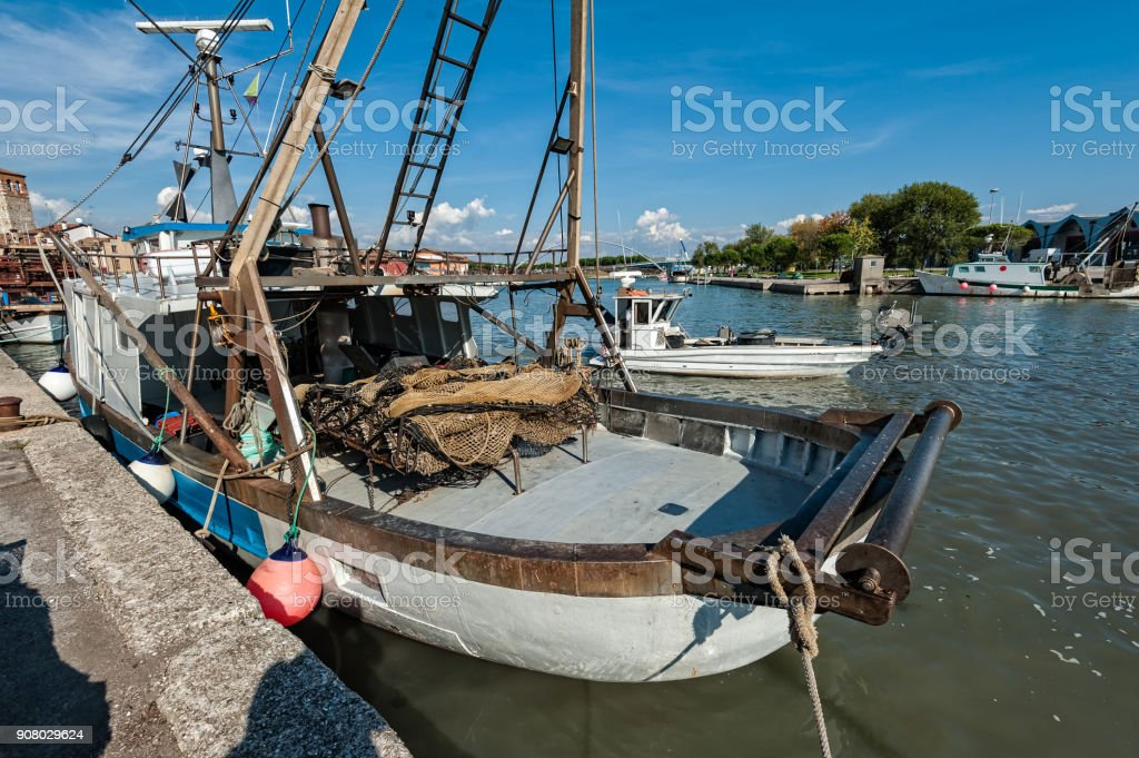 A commercial fishing boat in dock stock photo