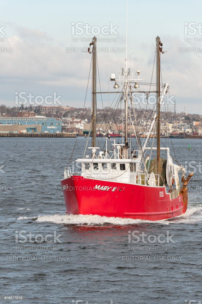Commercial fishing boat Mary K leaving port stock photo