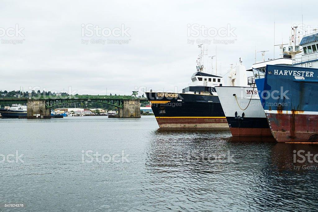 Commercial fishing boats and Ballard Bridge stock photo