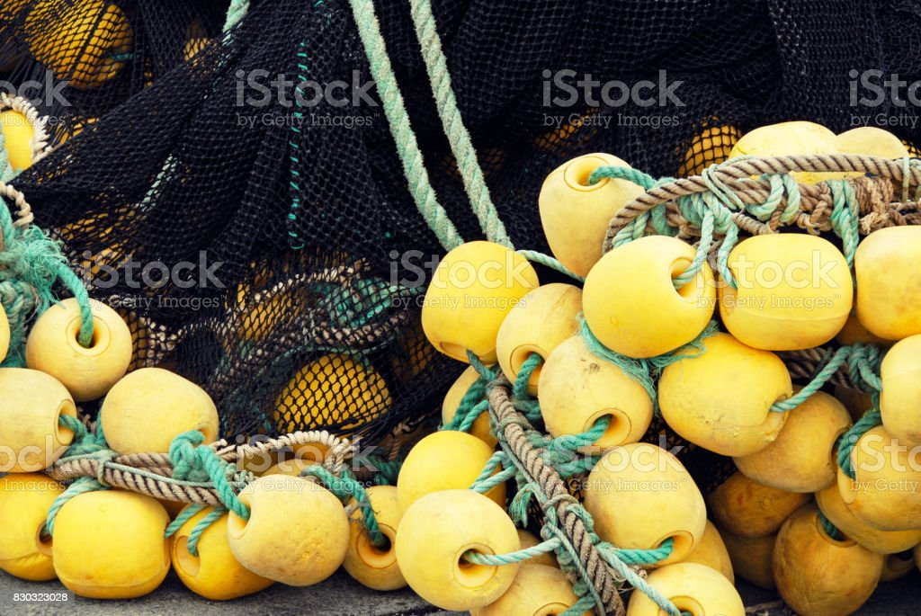 Commercial fishing net with floats on the harbor quay stock photo