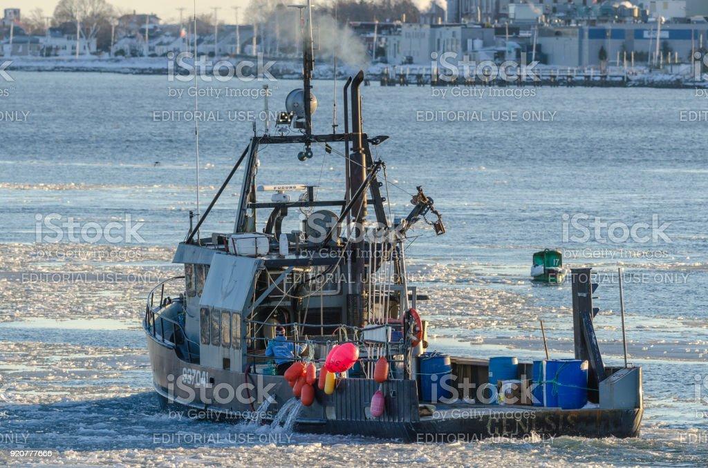 Commercial fishing vessel Genesis heading toward Buzzards Bay stock photo