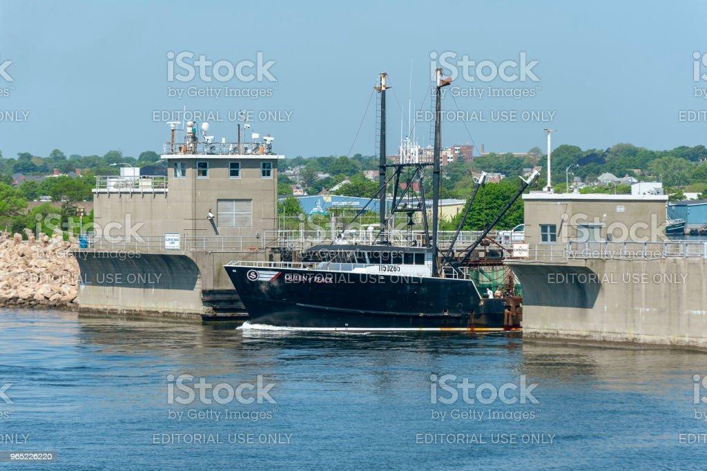 Commercial fishing vessel Queen of Peace leaving port zbiór zdjęć royalty-free