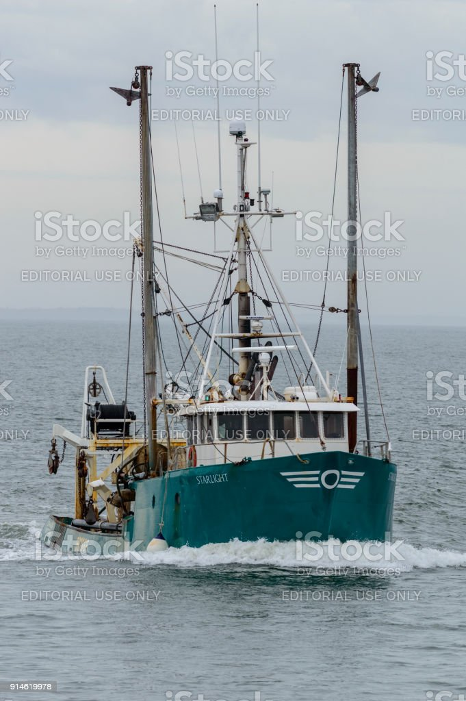 Commercial fishing vessel Starlight heading into New Bedford harbor stock photo