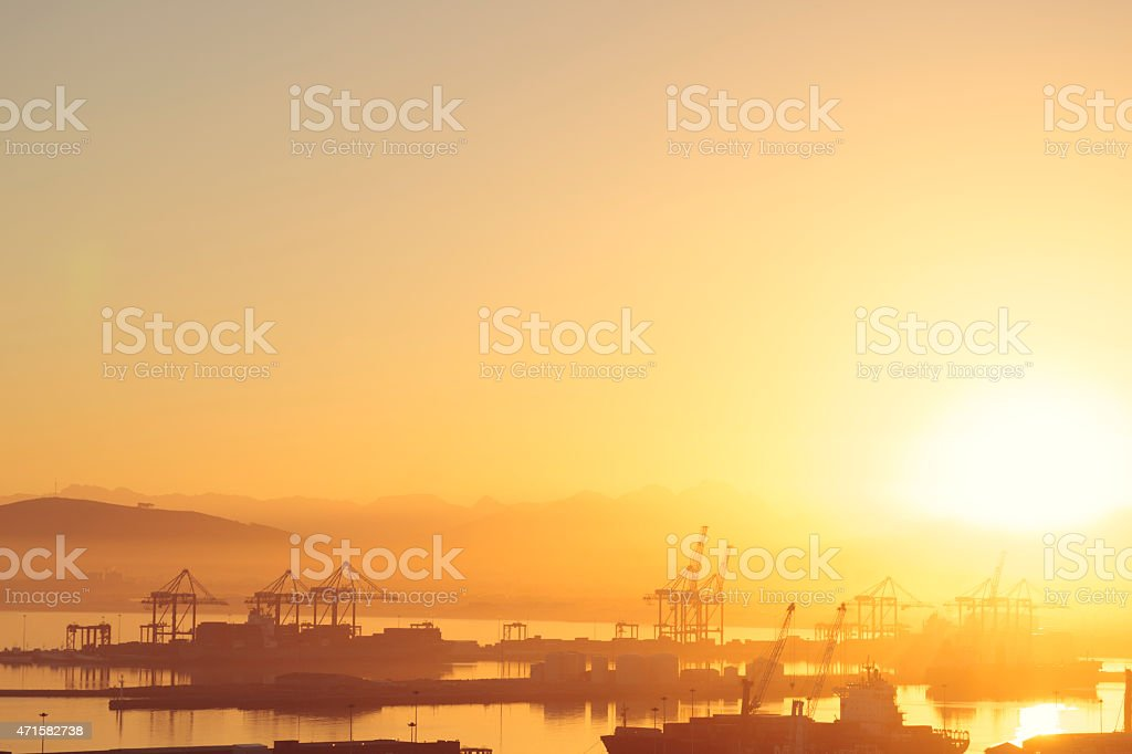 Commercial harbour in Cape Town during sunrise (South Africa) stock photo