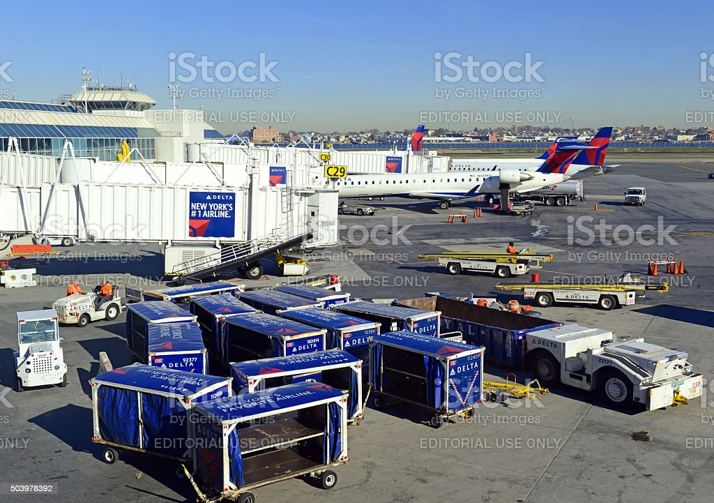 Commercial jet aircraft on tarmac loading its cargo at airport stock photo