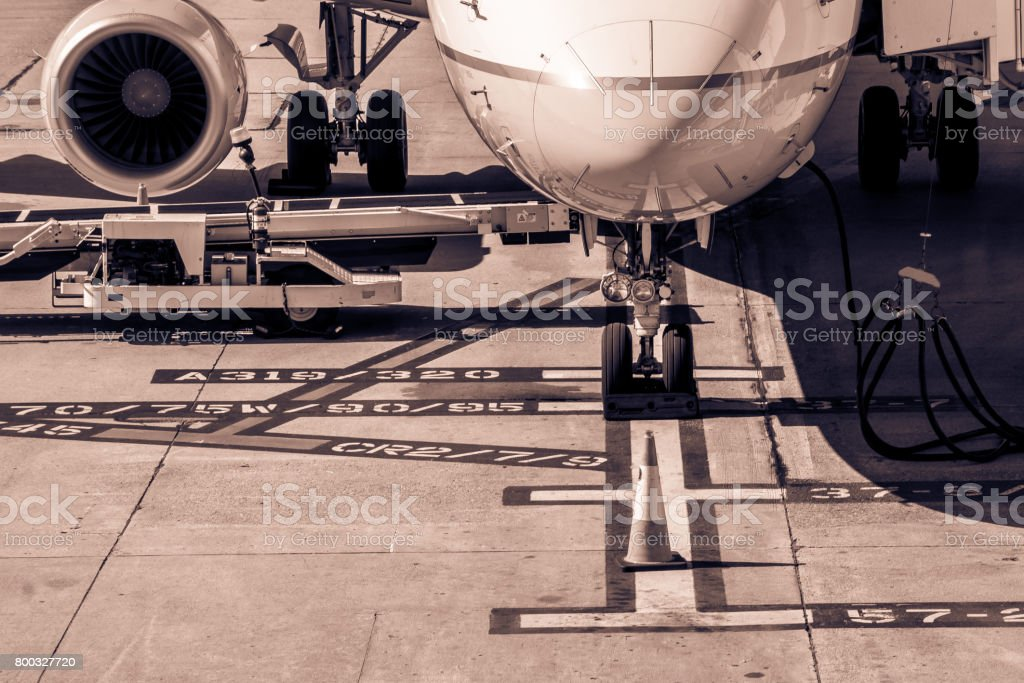 Commercial jet aircraft parked on runway apron stock photo