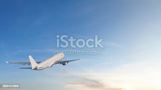 943681768 istock photo Commercial jet flying into sunset 968454966