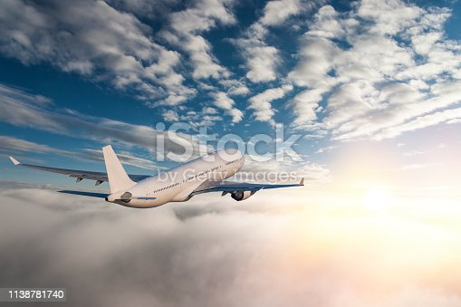 155380716 istock photo Commercial jet flying over clouds 1138781740