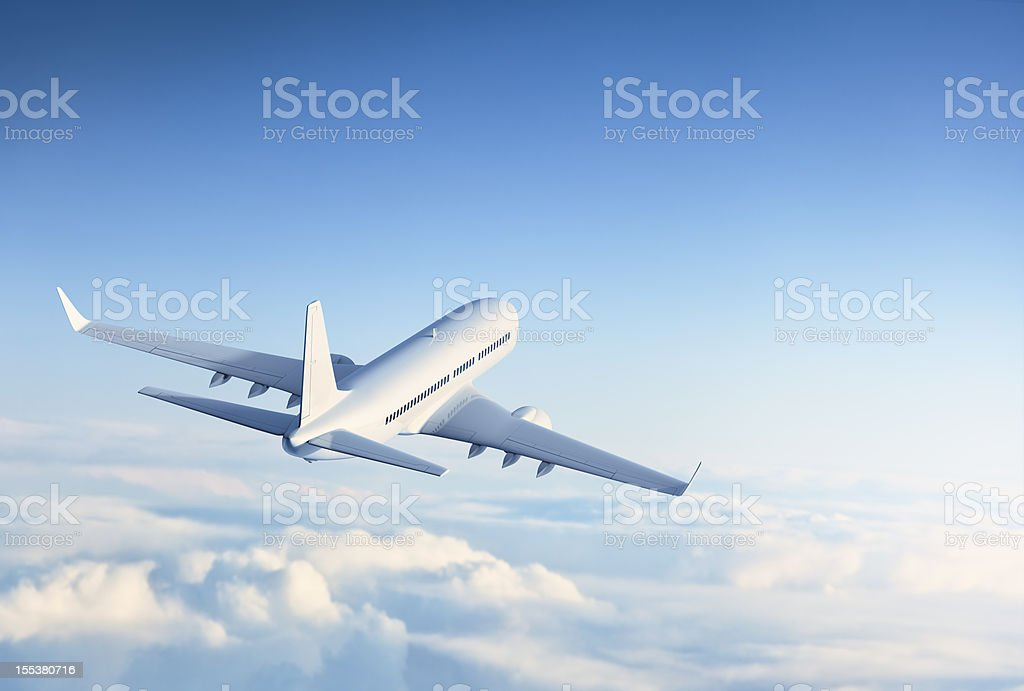 Commercial jet flying over clouds royalty-free stock photo