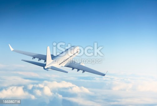 Commercial jet flying above clouds.
