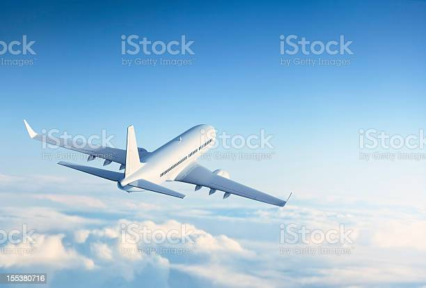 Photo of Commercial jet flying over clouds