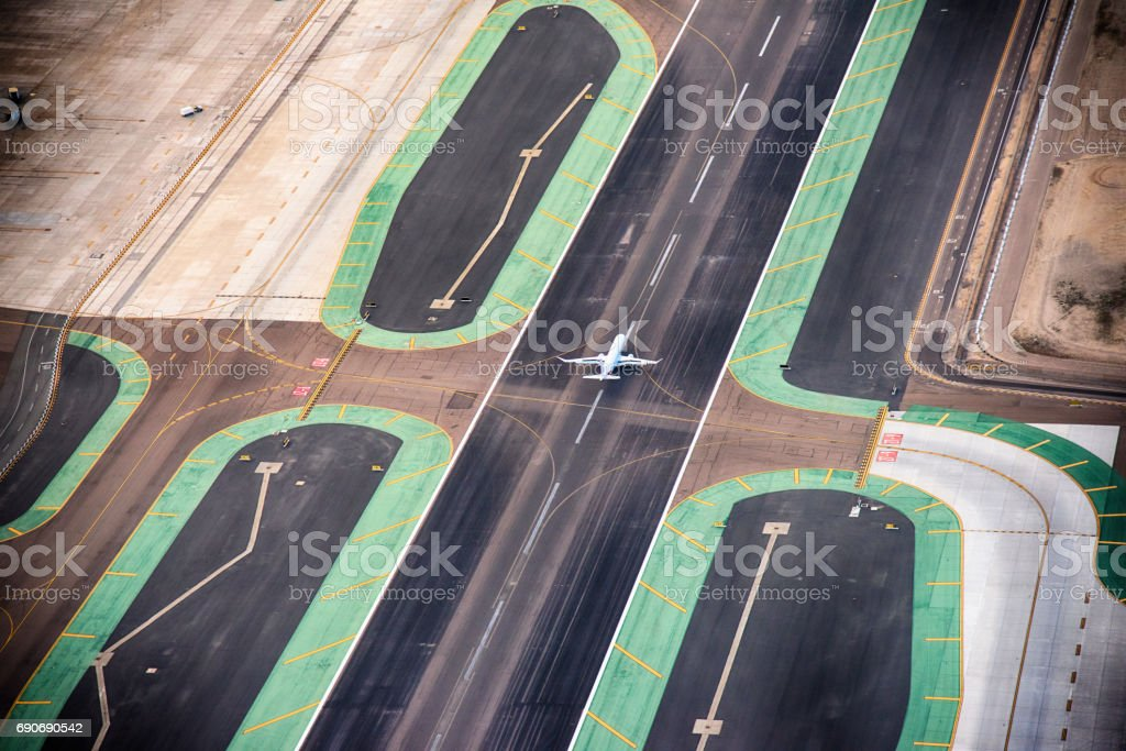 Commercial Jet Landing on Runway stock photo