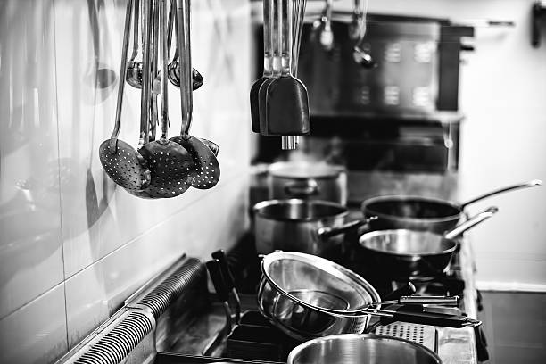 Commercial kitchen Commercial kitchen - Black and white image cooking black and white stock pictures, royalty-free photos & images